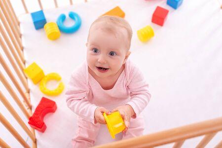 Baby girl at childrens playpen.