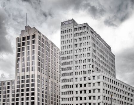 Building on a background of cloudy dark sky.