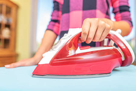 Woman ironing with iron.