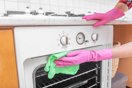 Cleaning the oven in the kitchen.