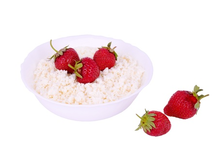 The plate with cottage cheese and strawberries isolated on white. Stock Photo