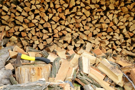 Full picture of firewood close-up. The ax in the stump. Stock Photo