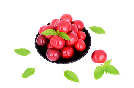 sweet cherries in a plate isolated on white