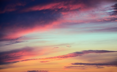 blue, aquamarine, red, orange, yellow, purple, gray clouds in the blue sky during sunset