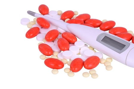red, white, yellow, pink pills and thermometer close-up  isolated on white background photo