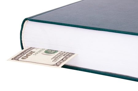 Closed book with a dark green cover closeup  bank note with $100 as a bookmark in a book  Objects isolated on a white background  Image horizontal, objects on the right  Stock Photo
