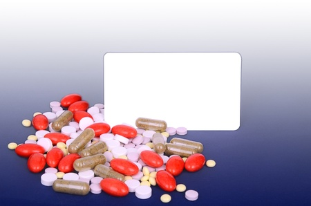 a lot of colorful pills. space for text. blue gradient background.