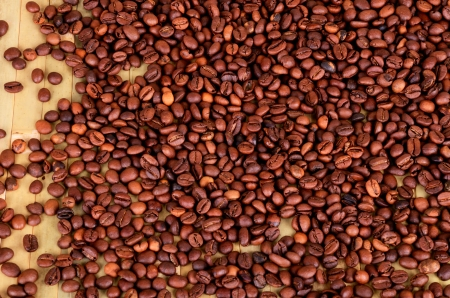 coffee beans on a brown-green wooden background. view from above. Stock Photo - 23068947