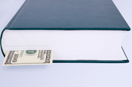 closed green book with a bookmark 100 dollars  front view