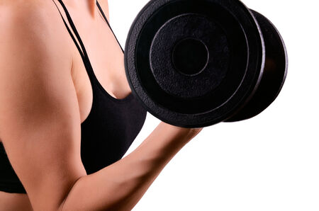 Athletic woman doing exercises with dumbbells for the biceps. isolated on white background photo