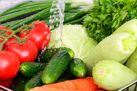 vegetables under running water and drops horizontal closeup