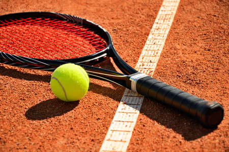 tennis ball and racket is on the carpet court closeup Stock Photo