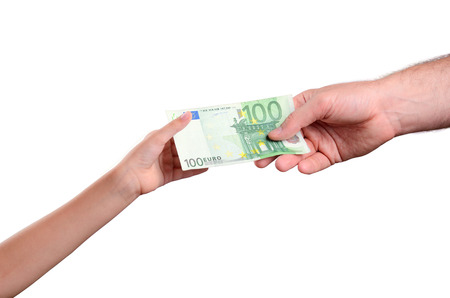 mans hand gives a the bill 100 euro in a childs hand. isolated on white background. horizontal Stockfoto