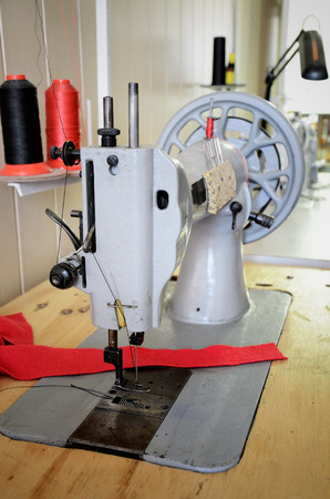 vertical format: old sewing machine in the sewing studio. vertical format