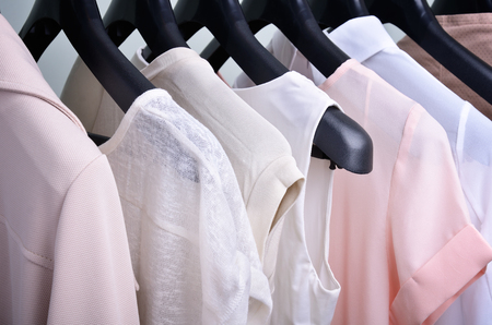 womens clothing pastel colors hanging on the hanger verticalclothing pastel colors hanging on the hanger horizontal