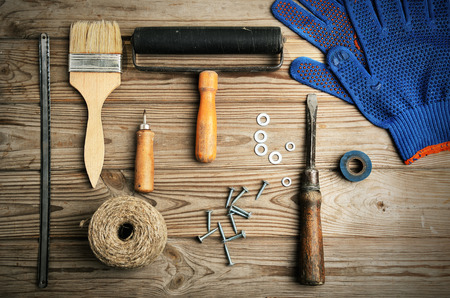 Wood work: work and painting tools on the wooden background top view. horizontal format