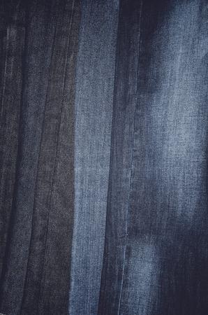 vertically: Jeans hanging vertically on a hanger. full frame. vertical format