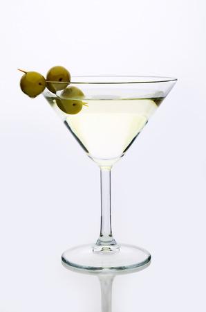 glass martini with olive  light background vertical Archivio Fotografico