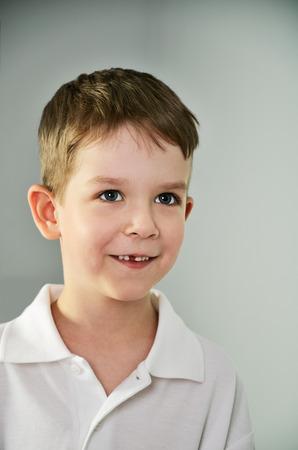 vertical format: little boy looking slyly. portrait vertical format