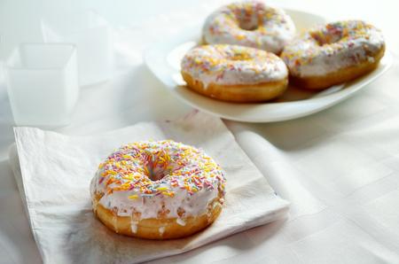 horizontal format: donut on the napkin close-up top view. horizontal format