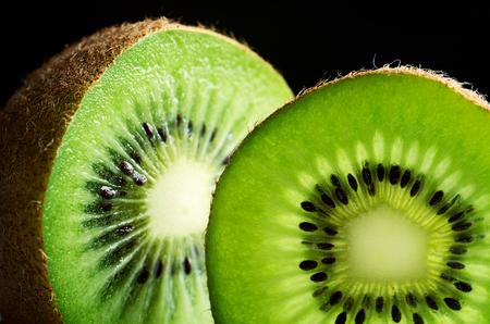 horizontal format: cut of kiwi fruit close-up on black background horizontal format