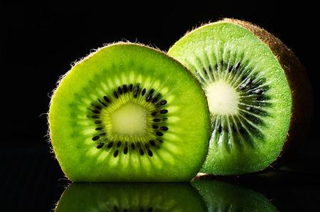 horizontal format: cut of kiwi fruit on black background horizontal format