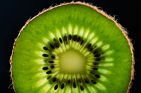 slice of kiwi fruit close-up on black background horizontal