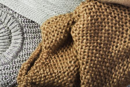 three warm sweaters on a full background. It can be used as a vertical or horizontal orientation