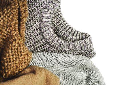 three warm sweaters isolated on white background, horizontal Stock Photo