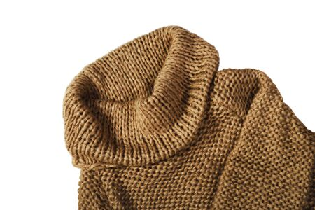 warm brown sweater isolated on white background, horizontal Stock Photo