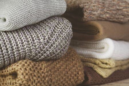 tinted image two stacks of warm sweaters on the table on a light background horizontal Stock Photo
