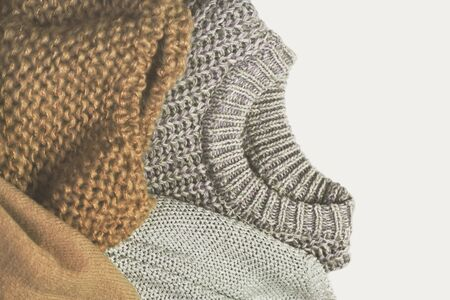 tinted image three warm sweaters on light background. It can be used as a vertical or horizontal orientation