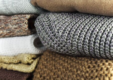 two stacks of warm sweaters on a full background horizontal Stock Photo
