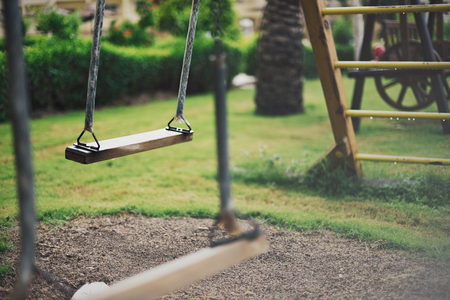 empty swing at the playground in summer, horizontal Stock Photo