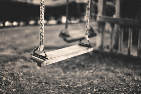 monochrome image empty swing at the playground in summer, horizontal Stock Photo