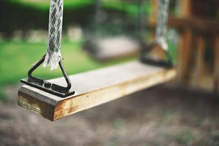 close-up empty swing in summer, horizontal Stock Photo