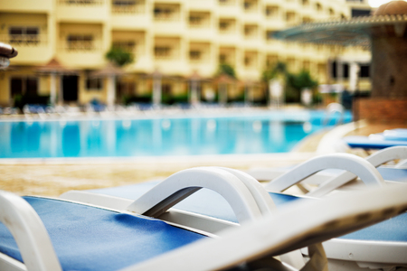 deserted hotel pool in the early morning, horizontal Stock Photo