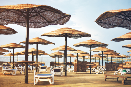 tinted image hotel beach area with umbrellas and sun loungers, horizontal Stock Photo