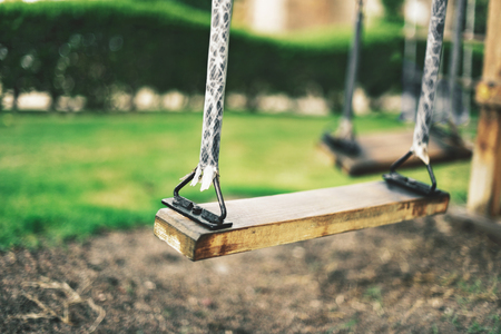 close-up empty swing at the playground in summer, horizontal Stock Photo