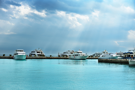 yacht in the sea port cloudy weather, horizontal Stock Photo