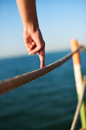 fingers steps on a wire rope, vertical