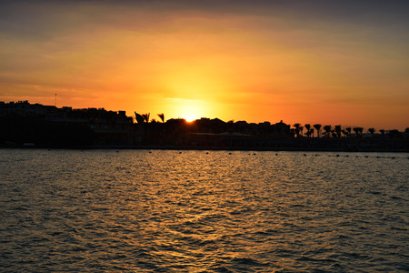 sunset on a hotel beach, horizontal