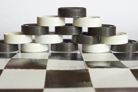 checkers: the pyramid of the checkers on the chessboard