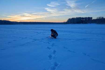 the fishermen engaged in ice fishing Stock Photo