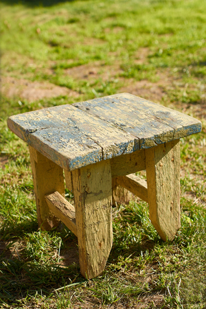 little old barstool on the grass