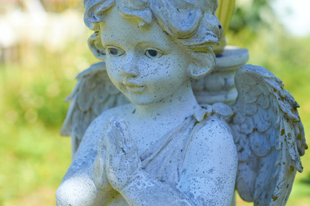 a statue of a little angel close-up