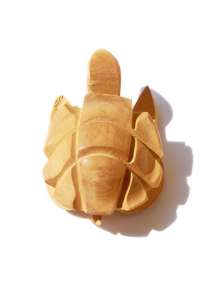 decorative wooden turtle figurine isolated on white background with shadow Stok Fotoğraf