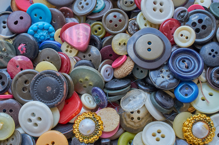 the background of the many scattered old buttons