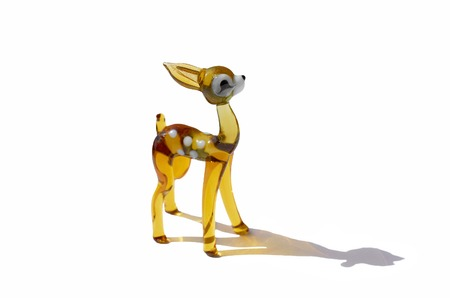 glass figurine of a fawn with a broken ear isolated on a white background with a shadow Stok Fotoğraf
