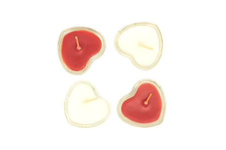 four heart shaped candles isolated on white background Archivio Fotografico - 125432076